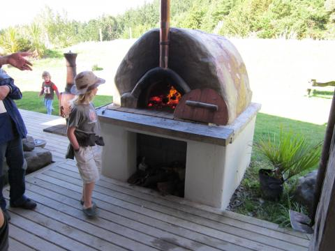 A fired-up pizza oven on show during the Permaculture Home and Garden Tour
